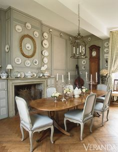 Boiserie paneling frames a collection of Creil plates.