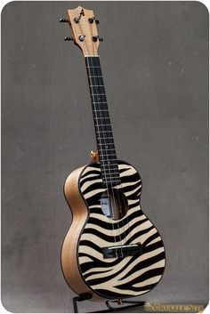 This is a custom tenor uke from Ana'ole. The top is spruce, inlaid with ebony.