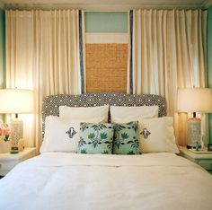 But there are other drapery styles that create perfect backdrops for beds while being function coverings for windows too. This layer of bamboo shades and high hung drapes (please never hang your drapes low- promise me) works wonderful and the fact that it goes from wall to wall makes it look luxurious and purposeful.