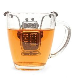 Kikkerland Robot Tea Infuser and Drip Tray. Use this charming robot stainless steel tea infuser to prepare your favorite loose tea. Rest him on the included drip tray when your tea is steeped. Eclectic Kitchen, Drip Tray, Tea Infuser, Tea Strainer, Cuisines Design, My Tea, Cool Gadgets, Drinking Tea, Tea Parties