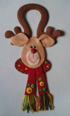 Resultado de imagen para adornos de navidad en fieltro para las puertas
