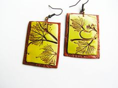 Very unique yellow and copper brown earrings with the natural herbs texture. Varnished. Very light and organic look.