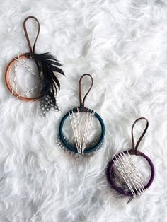 Dreamcatchers No 23 + 24 + 25 // Inspired by the traditions and cultures of the American West and designed with modern lines and colors, these dream catcher ornaments will add bohemian spirit to your holiday decor!  This set of 3 dreamcatcher ornaments is the perfect way to infuse bohemian style into your holiday home! These mini dreamers are beautiful as ornaments on your Christmas tree or as unique gift toppers. Stylishly modern with just enough classic holiday touches to bring on the…