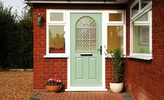 """When time to change the front door, one this like. (This GRP """"Chichester"""" from Anglian). Window either side rather than all to one side. Could we do a brick slip covering in front rather than the plain white panels?"""