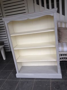 Bookcase freshly painted in Annie Sloan Paris grey and old white.