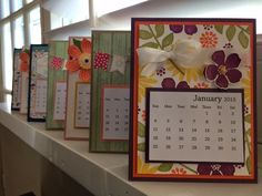 Calendars: I've been busy making these calendars for my friends & family for the new year. Oh My Goodies, flowerpot designer series paper, White seam binding ribbon. Night of the navy card stock. All Stampin' Up!