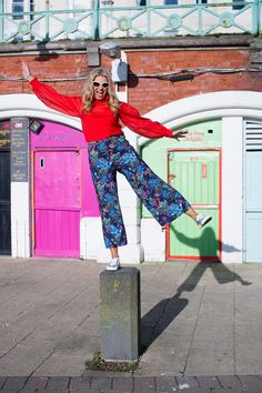 H&M Floral Trousers and Red Blouse  and silver Supagra pumps for a seaside weekend.