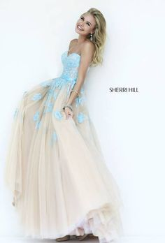 Prom Dresses 2015 # 11200 Delicate lace is appliquéd and embroidered on the sweetheart bodice and scattered over the full tulle ballgown skirt.