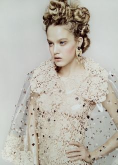 Nude lace, bow earrings, girly makeup and fab twisted bun hair via Marie Claire UK April 2012