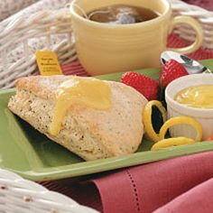 Poppy Seed Lemon Scones Recipe -You'll love the appealing look and delicate texture of these lightly sweet scones. For the best results, work quickly to mix and cut them. The less you handle the dough, the more tender the scones are. They're delightful served warm with homemade lemon curd for breakfast or with a salad for lunch. -Linda Murray, Allenstown, New Hampshire