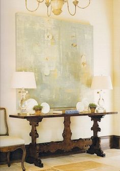 modern art, antique console, crystal lamps..
