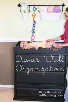 Ikea's kitchen wall storage systems are also useful in a nursery.