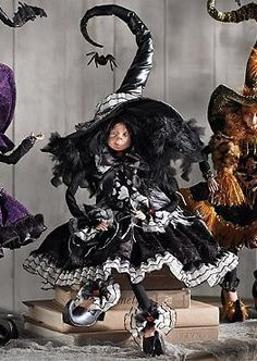 """Part of an enchanting and haunting collection, the Mark Roberts 27"""" Curiosity Witch is the perfect piece to display this Halloween with intricate details and moveable arms."""