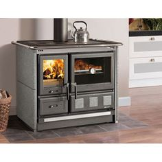 Contact Obadiah's Woodstoves & Fireplaces for Wood Stoves like the La Nordica Rosa XXL Soapstone Cookstove and more! Wood Burning Cook Stove, Wood Stove Cooking, Cooking Pork, Soapstone Stove, Integrated Oven, Wood Fuel, Prefab Cabins, Cast Iron Stove, Ovens