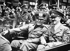 "Sept. 28, 1938 Benito Mussolini and Adolf Hitler, taken just before the four power conference in Munich, Germany. As a gesture of friendship, Hitler met  Mussolini with his car at the Italo-German frontier. Benito Mussolini was a fierce anti-Semite, who proudly said that his hatred for Jews preceded Adolf Hitler's and vowed to ""destroy them all,"""