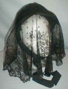 1860s morning bonnet with veil that is pinned in place, front trimmed with black silk ribbon bows, black silk chin ties.  Label: Dunham, 1127 Broad Street, lined with cotton, interior once trimmed with black chiffon, only remnants remaining.  ebay seller: fiddybee