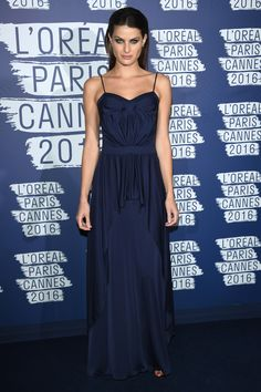 18 May Isabeli Fontana kept it classic in a simple navy gown with spaghetti straps.   - HarpersBAZAAR.co.uk