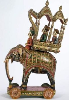 Victoria & Albert Museum - Toy elephant, 1900-1920  Painted wooden toy elephant with howdah, Rajasthan, India.