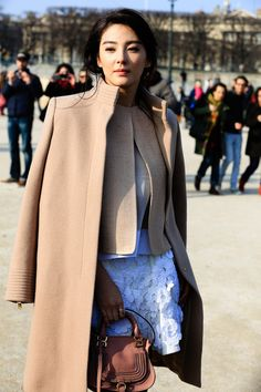 I'm hesitant with such modern styles like the jacket has. But the skirt and the bag make it work.