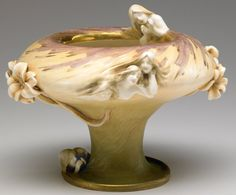 """RIESSNER, STELLMACHER & KESSEL (AMPHORA) Art Nouveau vase with maidens peering out of water, with reticulated lilies.  Stamped AMPHORA Art Nouveau medallion, red RSTK Turn-Teplitz stamp, 2007 41. 6 3/4"""" x 8""""  