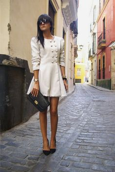 white coat with gold buttons.