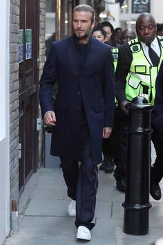WHAT: A Kent & Curwen topcoat and trousers WHERE: The Kent & Curwen LFWM presentation in London WHEN: January 2018 WHY: Beckham is officially giving himself a relaxed fit do-over. This elevated look blows baggy track suits out of the water. Moda David Beckham, Estilo David Beckham, David Beckham Style, London Fashion Week Mens, Mens Fashion Blog, Best Mens Fashion, Men's Fashion, Street Style Outfits Men, Stylish Mens Outfits