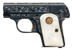 Factory engraved Colt 1908 Vest Pocket. .25 acp. Pearl grips with gold medallion.