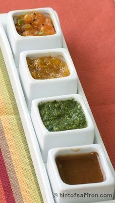 Four types of Chutney; Mango chutney laced with saffron; tomato chutney flecked with mustard; mint cilantro chutney and sweet and spicy tamarind chutney