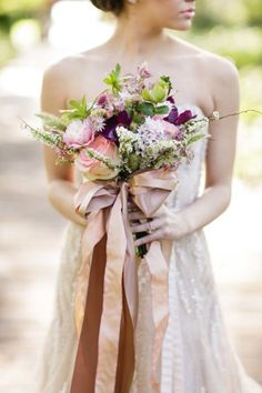 Overly joyed about this ribbon drenched bouquet: http://www.stylemepretty.com/louisiana-weddings/2014/10/24/romantic-watercolor-wedding-inspiration-shoot/ | Photography: Greer G - http://www.greergphotography.com/