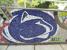 Local artist Bev Leviner created a mural mosaic wall at our Perkins Student Center. The mosaic commemorates our college's 50-year history.