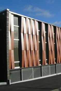Sistemas de Fachadas | New World, centro comercial con fachada Fundermax estampado madera | http://sistemasdefachadas.com