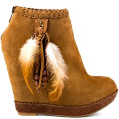 Meet up with the Milana and show off your killer style.  This Chinese Laundry booties bring you a lavish camel suede upper with a moccasin look.  Beads, tassels and feathers hang off the side creating an earthy look the hidden 5 inch wedge and 1 inch platform.