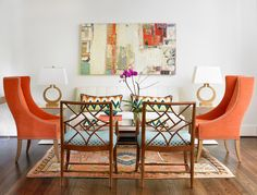 Transitional living room with pops of orange - Decoist