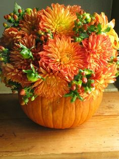 Fall Wedding Centerpiece idea - place a tin can inside the pumpkin to hold the flowers and water. Description from pinterest.com. I searched for this on bing.com/images