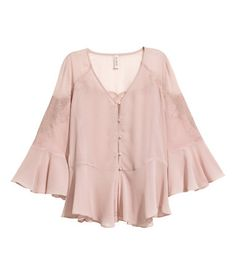 Light dusty pink. Wide-cut blouse in crinkled chiffon with embroidered details. V-neck, covered buttons at front, and 3/4-length sleeves. Wide flounce at
