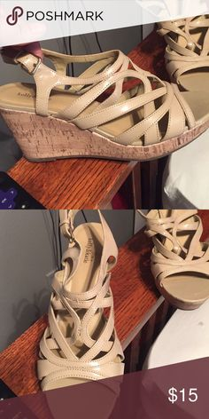 Tan wedge heels Most comfortable wedge in the world! Super comfortable and the color makes them wearable with anything! The heal is about 2in, and still has a small platform. Kelly & Katie Shoes Wedges