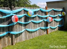 cute and easy decoration for a beach party, luau, pool party or splish splash birthday bash. it's a wave wall!