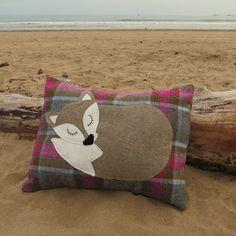A snoozy fox on tartan wool.  A fox cushion complete with cushion pad.