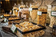 An elegant take on a DIY popcorn bar. The apothecary jars would be easy to find at most design stores - and you could customize the ribbons around the jars and containers to coordinate with your wedding or corporate event theme colors. (The link jumps to Popcorn Station, Candy Popcorn, Flavored Popcorn, Cheese Popcorn, Butter Popcorn, Popcorn Balls, Gourmet Popcorn, Donut Bar, Buffet Dessert