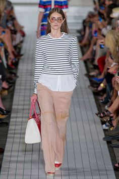 Hilfiger mined two big prep past time—sailing and tennis. The former came via nautical-striped tops for any kind of mood or shape. The latter through oversized tennis sweaters with v-necks that plunged provocatively low.