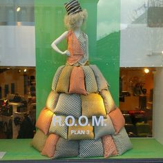 Window display at PUB (Paul U. Bergstrom) store, in Stockholm, SE __ photo by blogger Fran of Etxekodeco __ I imagine the dress is made from napkins or pillow covers or such; pinning for vest construction example