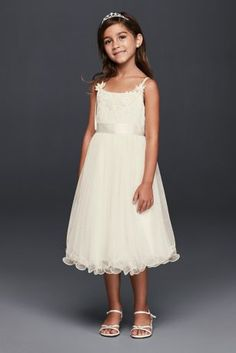 a0bc2bffdc5 This eye-catching flower girl dress is finished with a curly-edged