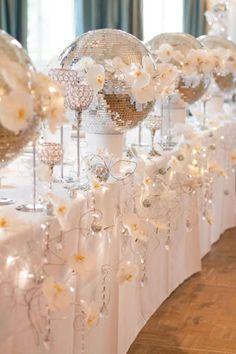 Silver, white and sparkle doesn't have to be frosty! Use fairy lights to warm up the decor • 4 of the best white winter wedding themes