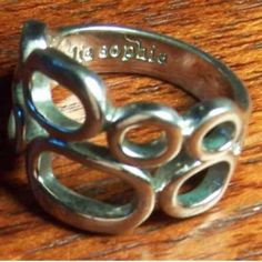 Lia Sophia Synthesis Ring Circle pattern ring by Lia Sophia. Size 8. Silver plate. Ring signed inside of band. Please ask if you have questions about this item. Lia Sophia Jewelry Rings