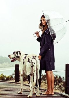 Barefoot near the beach in the rain with your dog and a clear umbrella? Sounds like fun!