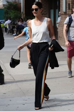 Who: Lily Aldridge What: A Sleek Way to Style Track Pants Why: Aldridge wears her Chloe pants with a silk tank for a streamlined take on the trend. Get the look now: Areyouami tank, $179, areyouami.com.