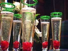 Reindeer Bubbles Cocktail Recipe - champagne or Prosecco, green rimming sugar, pomegranate seeds, pomegranate syrup (1/2 simple syrup* and 1/2 pomegranate juice).
