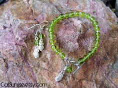 Take a look at our Stunung Glass Collection! Peridot Glass for August with an Owl Bracelet & by CaliSunrise, $14.00