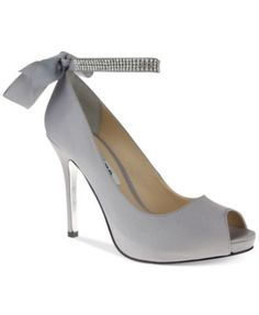 Nina Karen Platform Evening Pumps $119.00 Pair this satin style with only your most special outfits. The Karen platform evening pumps feature a rhinestone-accented ankle strap that ties in back.