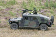 No this is not a tank, this is a M-1114 HMMWV (Hummer) with a .50 cal MG in the turret.  Currently it this vehicle in the picture is serving with the Lithuania Army.